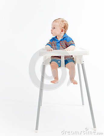 Baby boy in high chair, looking right