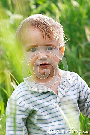 Baby boy in high grass