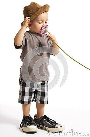 Baby Boy Holding Pretty Flower