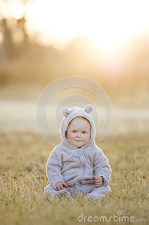 Free Baby Boy In A Bear Suit At Sunset Stock Images - 58037014