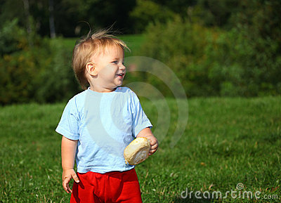 Baby boy on the meadow