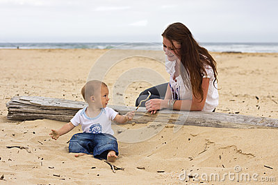 Baby boy with mother on beach