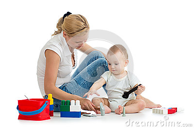 Baby boy and mother play toys