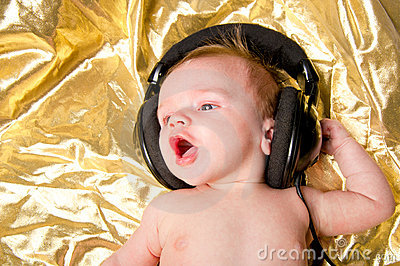 Baby boy with music from headphones