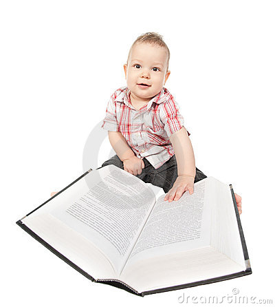 Baby boy play with book on white