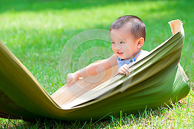 Baby boy playing on the grassland