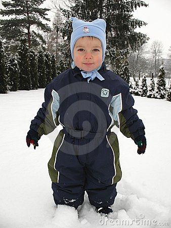 Baby boy playing in snow