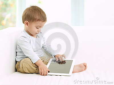 Baby boy playing with tablet