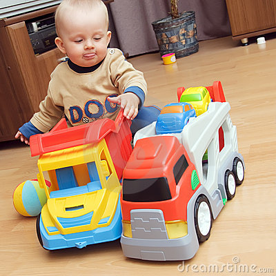 Baby boy playing with trucks