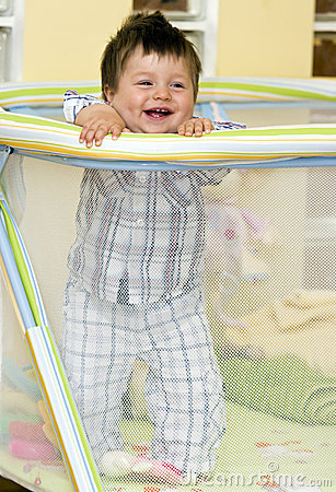 Baby boy in playpen