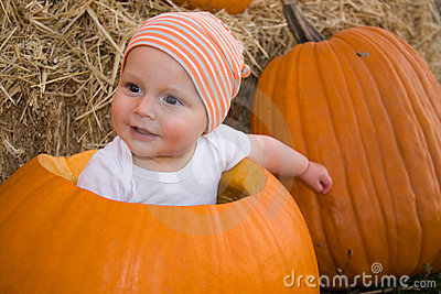 Baby boy in pumpkin