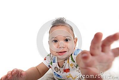 Baby boy reaching towards the viewer