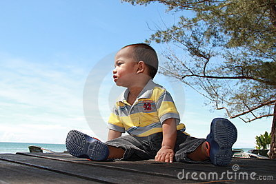 Baby boy at a seaside