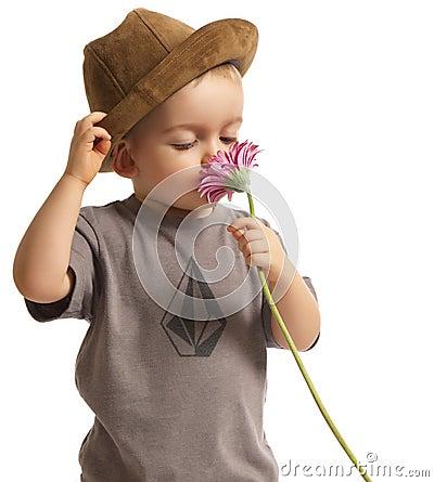 Baby Boy Smelling Pretty Flower