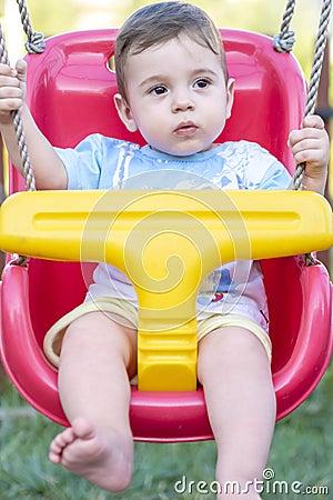 Baby boy in swing