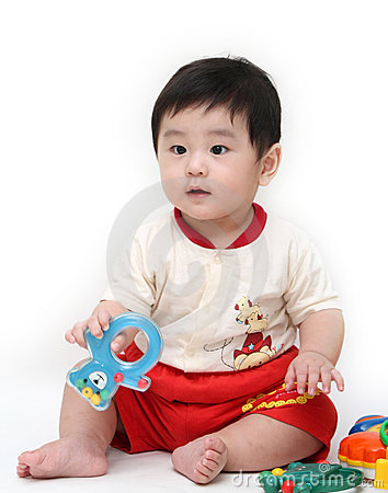 Baby boy with toys