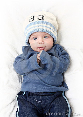 Baby boy on white blanket