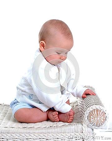 Baby Boy on Wicker Bench