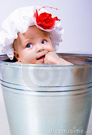 Baby on a bucket