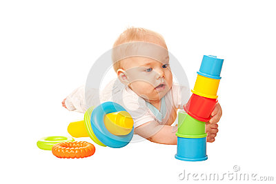 Baby building tower of colorful blocks.