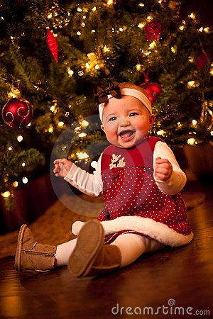 Free Baby By Christmas Tree Stock Image - 12156091