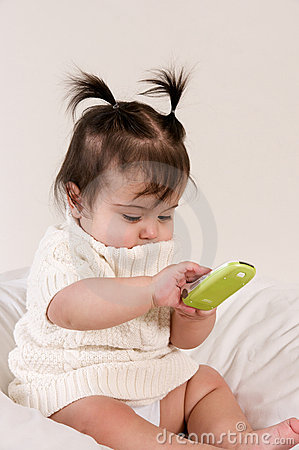 Baby with cell phone in hand