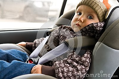 Baby in child seat in the car
