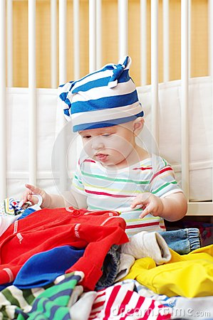 Free Baby Chooses Clothes For Walk Royalty Free Stock Image - 33881436