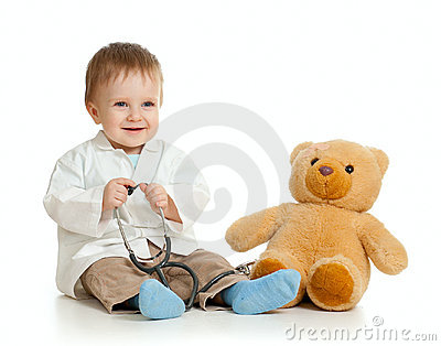 Baby with clothes of doctor and teddy bear