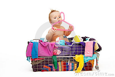 Baby in clothes and hanger