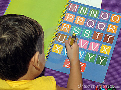 Baby with colored letters