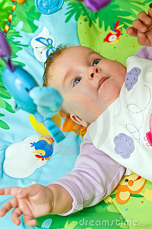 Baby on colorful mat