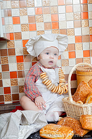 Baby cook with bread