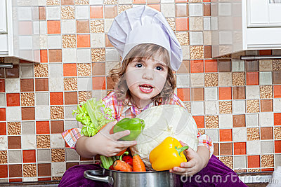 Baby cook with vegetables