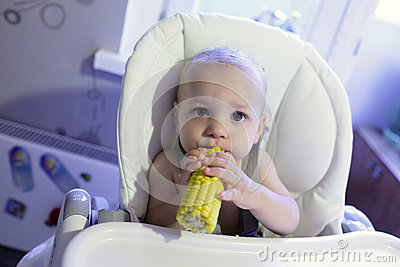 Baby with corn