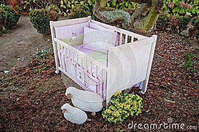 Baby cot bed in garden