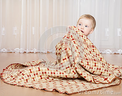 Baby covering with a blanket