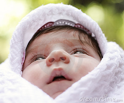 Baby in coverlet looking up