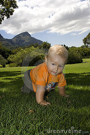 Baby crawling on grass outdoors