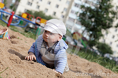 Baby crawling in sandbox