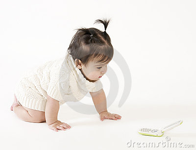 Baby crawling to cell phone