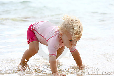 Baby crawling in water