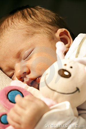 Baby and cuddly toy