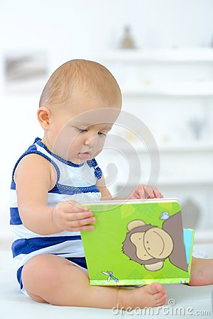 Free Baby Curious With Book Royalty Free Stock Images - 100304189