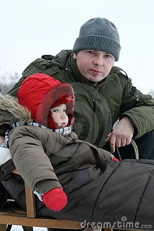 Baby and dad on sled