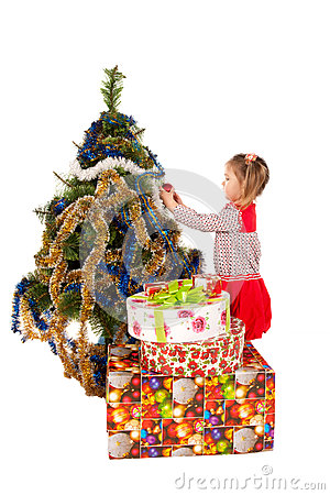 Baby decorating christmas tree royalty free stock image for Baby christmas tree decoration