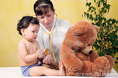 Baby with doctor.