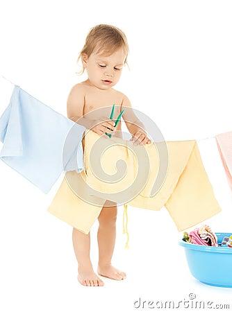 Baby doing laundry