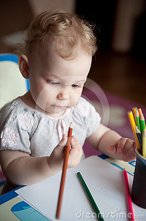 Free Baby Drawing With Pencils Royalty Free Stock Images - 24276249