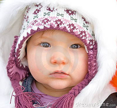 Baby dressed for cold weather.